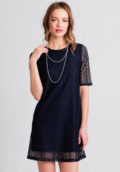 A wardrobe staple, this navy blue dress features a geometric lace overlay and is designed in a shift silhouette.
