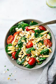 Healthy Chicken Pasta Salad is a spinach salad with penne pasta, grilled chicken, cherry tomatoes, toasted slivered almonds, and a ...