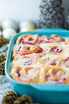 White Chocolate Cranberry Rolls: homemade dough filled with homemade cranberry filling (or store bought), with a white chocolate glaze - for Christmas!