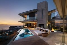 With a landscape as enviable as this, there is no question that outdoor spaces were a priority in the design. The home is built around a central, sheltered terrace while full height sliding windows open up onto a generous pool deck and upper balcony levels.