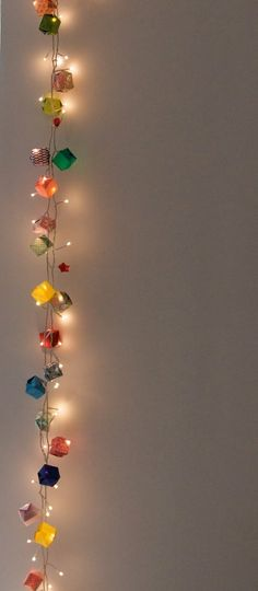 origami 'gifts' strung with fairy lights..