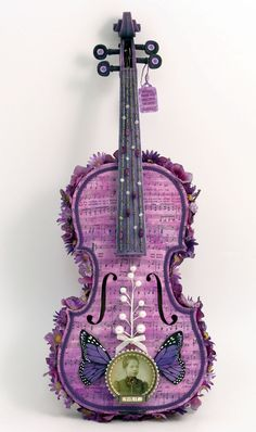 A violin, made into modern art.    Source: http://www.yesterdaystrashart.com/new_ViolitViolin_lg.jpg   (My sister would love this!!)