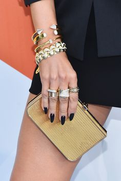 Recording artist/actress Jennifer Lopez, fashion detail, attends The 2015 MTV Movie Awards at Nokia Theatre L.A. Live on April 12, 2015 in Los Angeles, California.
