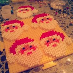 Christmas Santa ornaments perler beads by arts_and_graff (I love perler bead projects; they are so nostalgic for me. Hama Beads Design, Diy Perler Beads, Perler Bead Art, Pearler Bead Patterns, Perler Patterns, Ideas Decoracion Navidad, Christmas Perler Beads, Art Perle, Motifs Perler