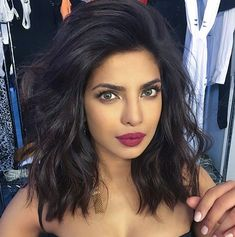 "PRIYANKA CHOPRA The Look: Side-Swept Waves The Breakdown: ""I know it seems counterintuitive to apply mousse to hair before you blow it out, but it controls frizz and makes hair moldable, which is so important when you have shorter hair,"" says hairstylist Harry Josh. He then blows her hair up and over to one side (focusing on the roots) using a round brush and a blow dryer, before creating waves with a 1-in. curling iron."