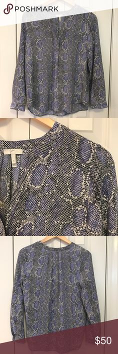 Joie Peterson B Silk Blouse Snakeskin This Joie snakeskin print, 100% silk top is in excellent used condition.  It's purple and gray.  Split V neckline, hidden single button/hook front.  Bracelet sleeves, one-button cuff.  Relaxed silhouette.  Bust 18, length 25, sleeve, 22.  From a smoke free, pet friendly home. Joie Tops Blouses