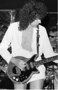 Brian May. He should leave the bootie shorts to Freddie who has a fantastic one!