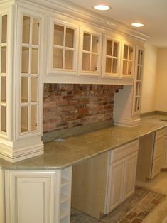 Downeast Kitchen Design.  Brick pavers for back splash with wood floors.