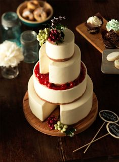 This sophisticated cheese wheel cake is perfect for a savory-loving bride. The Sweet Course, Weddingbells Spring & Summer 2012. Photography courtesy Jim Norton.