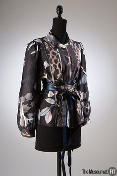 """2007: Designer and scholar Rebecca Earley actively explores methods of """"upcyling,"""" a recycling concept in which the resultant product is one of equal or greater value. This tunic began as a secondhand garment that Earley transformed through various technologies, such as heat photogram printing, during the course of a research project entitled """"Ever & Again: Rethinking Recycled Textiles."""""""