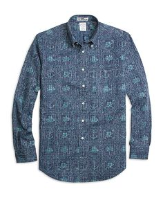 85a7cb8aac Our men s slim fit blue nautical print sport shirt is made from a cotton  and polyester blend to achieve the signature Reyn Spooner appearance.