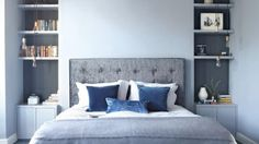 Modern Blue Bedroom with Alcove Shelving and Pendants