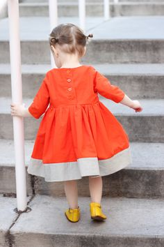 Playtime Dress with color blocked hem.
