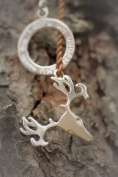 Reindeer skull with leather cord. Slip through -necklace. Custom made with text: The end gives birth to new.  https://www.facebook.com/paarmadesign