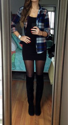 WARM going out outfit. black tight fitted mini dress, sheer black hose, tall black suede boots, and a blue plaid flannel collared button up open over dress.