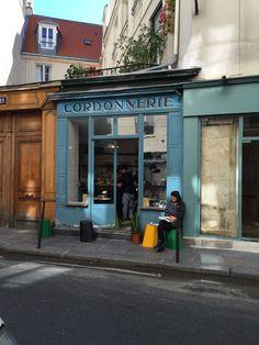 Neighborhood shot, Marais, Paris (old shoe repair turned coffee house)