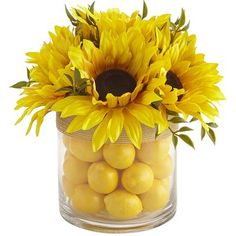 For the sunniest possible disposition at your dining, console or dressing table, may we suggest this freshly gathered bunch of handcrafted sunflowers in a glass vase filled with faux lemons? Destined to bring entire families out of hibernation, this is summer's freshest response to your need for color and style.