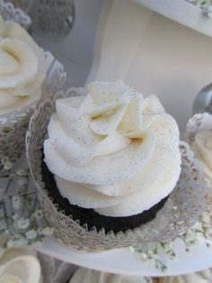Cupcake in decorative wrapper and topped with silver glitter.