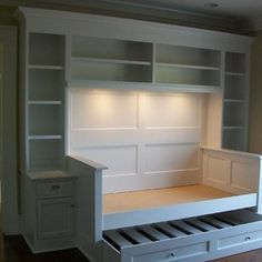 Traditional Daybed with Trundle, Bed Tables and Bookshelves.  CustomBuilt-ins.com / CFM Company Inc.