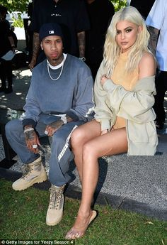 Young love: Kylie sat next to boyfriend Tyga - whose former flame Amina Blue tripped up on the catwalk thanks to her ill-fitting shoes
