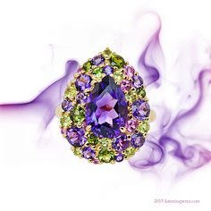 Isabelle Langlois Pink gold ring set with amethysts, green tourmalines, peridots…