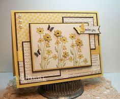 base of my card is daffodil delight card stock, I then used Early espresso card stock for the next layer and the DSP on here is from the Summer Smooches and First Edition paper packs.