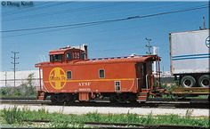 Santa Fe off-center cupola caboose #999139 brings up the rear of a pig train at McCook, Illinois on June 16, 1986.