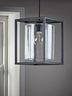 Consisting of a glass cylinder contained by a black rectangular frame, our statement pendant light will add a unique touch to your interior. Crafted from durable powder coated iron and clear glass, it will transform your lighting look. Industrial Pendant Lights, Contemporary Pendant Lights, Pendant Lighting, Ceiling Pendant, Hall Lighting, Living Room Lighting, Modern Lighting, Kitchen Lighting, Lighting Ideas
