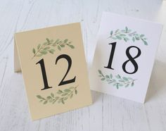 Double sided wedding table numbers with a greenery accent.  No stands or frames needed for these sturdy table numbers.  • Size: 3 3/4 W x 5 H (folded) • Cards are shipped flat. Just fold on center crease line and place on your table. • Double sided cards (printed on both sides) • 110 lb Cream or White cardstock   Advice cards are available here: https://www.etsy.com/listing/71817789