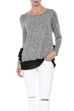 Grey knit sweater with a round neckline, black underlay and side bow detailing.   Side Bow Sweater by Michael Tyler Collections. Clothing - Sweaters - Crew & Scoop Neck Cape Cod, Massachusetts