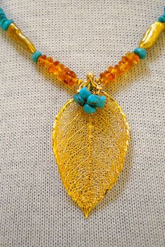 Materials: natural Amber, natural Turquoise, Arizona Turquoise, stick pearl, golddipped real leaf by ShapesOfNature Absolutely love this color combination
