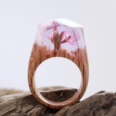 Blossom Forest - limited collection ; All our rings are handmade and unique. We use fresh wood, jewelry resin and beeswax.  The rings are designed and made by Secret Wood exclusively.
