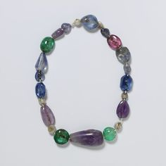 Spanish String of stones ca 586-711 - amethysts, emaralds, spinels, pearls & sapphires all drilled| V Search the Collections