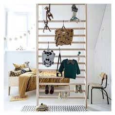 #designideas we love: This may be the coolest wood climbing wall for gross motor play...and when it's not in use it doubles as the cutest clothing rack! Shop our favorite ideas for an active play space on #wolfandfriends.com ⠀⠀⠀⠀⠀⠀⠀⠀⠀
