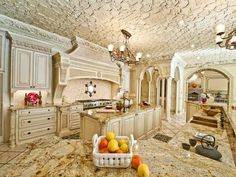 Traditional Kitchen with Columns, Raised panel, Crown molding, Custom hood, Chandelier, Kitchen island, U-shaped, can lights