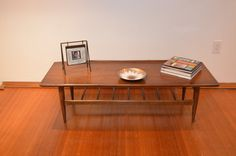 """MId-Century Bassett Surfboard Coffee Table 54""""  https://www.etsy.com/listing/199743587/mid-century-bassett-surfboard-coffee?ref=sr_gallery_41&ga_search_query=mid+century+modern+coffee+table&ga_page=9&ga_search_type=all&ga_view_type=gallery"""