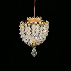 An elegant ceiling fixture for your dollhouse, complete with genuine Swarovski crystals and replaceable 12 volt bulb.   Really exquisite when lit. Measures appr
