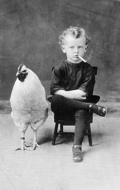 A toddler smoking a cigarette and a chicken...just the same ol' same ol'...LOL