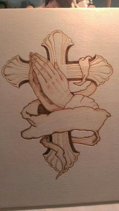 Praying hands on cross wood burning