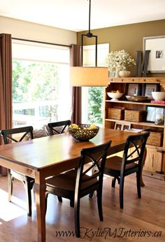 rustic country, farmhouse style dining room. Sherwin Williams Mossy Gold and Benjamin Moore Gentle Cream, pine hutch table