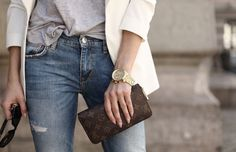 White blazer, tucked grey tee, light jeans and Louis Vuitton Monogram clutch wallet
