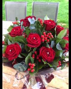 Dozen Red Roses hand tied in water and gift wrapped