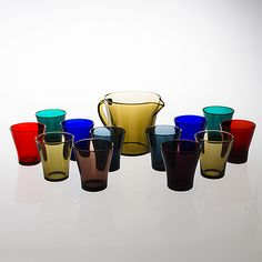 A set of twelve drinking glasses and one pitcher for Riihimäki Lasi.
