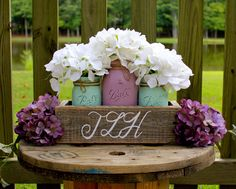 RUSTIC WEDDING CENTERPIECE, Lilac and Mint painted mason jars and planter is monogrammed. Beautiful for rustic or shabby chic wedding! by TheSouthernBlend on Etsy https://www.etsy.com/listing/244484169/rustic-wedding-centerpiece-lilac-and