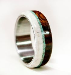 Ironwood, Elk Antler, and Turquoise Wedding Ring. Different wood and inlay options available upon request. Available in: 10K WHITE, YELLOW, OR ROSE GOLD We love taking on custom orders.