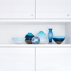 Display unique accessories, like hand-blown glass, in an open-shelf cabinet. | Image: Stacey Brandford