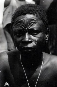 Africa | Mituku man from Lowa.  Belgian Congo | Photograph published by Lammeretz.