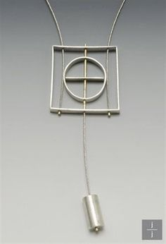 Part of the Sterling and Steel collection this pendulum series necklace is graphically and architecturally inspired. It has movement and a minimal silhouette. Materials: Sterling Silver, 14K GF…MoreMore #ContemporaryJewelry