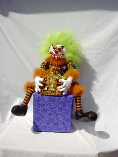 Evil KimB Klown holding the cage