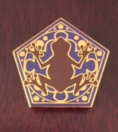 """Warning: Hopping charm is defective  Dimensions: 1.25"""" tall  This pin is crafted from fine jeweller's metal and hard enamel Cloisonné. It is smooth to the touch and gold plated."""